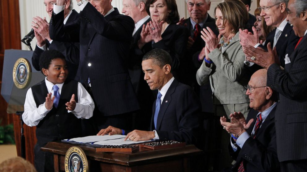 President Barack Obama is applauded after signing the Affordable Care Act into law in the East Room of the White House on March 23, 2010.