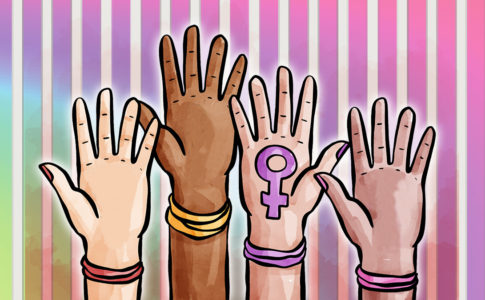 Four hands of different skin tones, all wearing bracelets, reach upwards together.