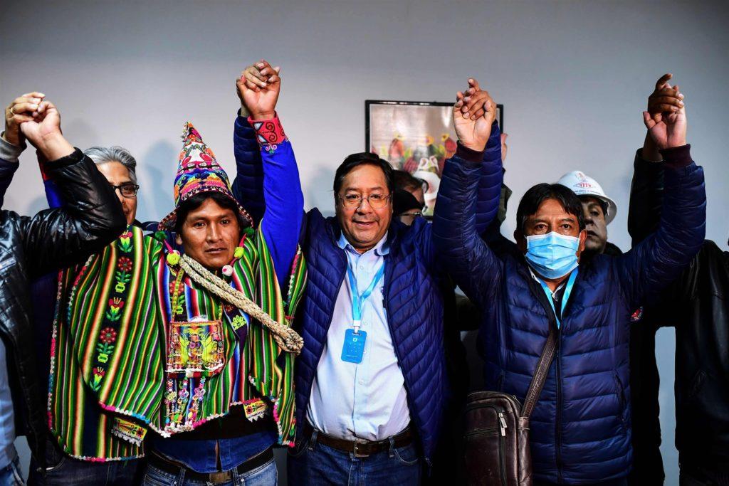 Three men raising their hands