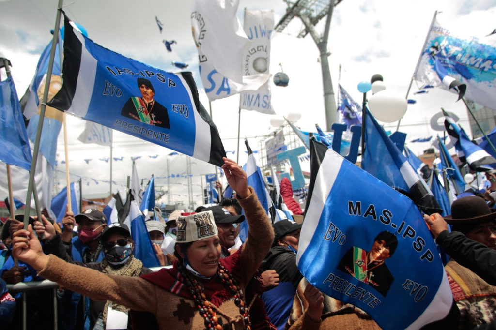 People holding flags in a rally