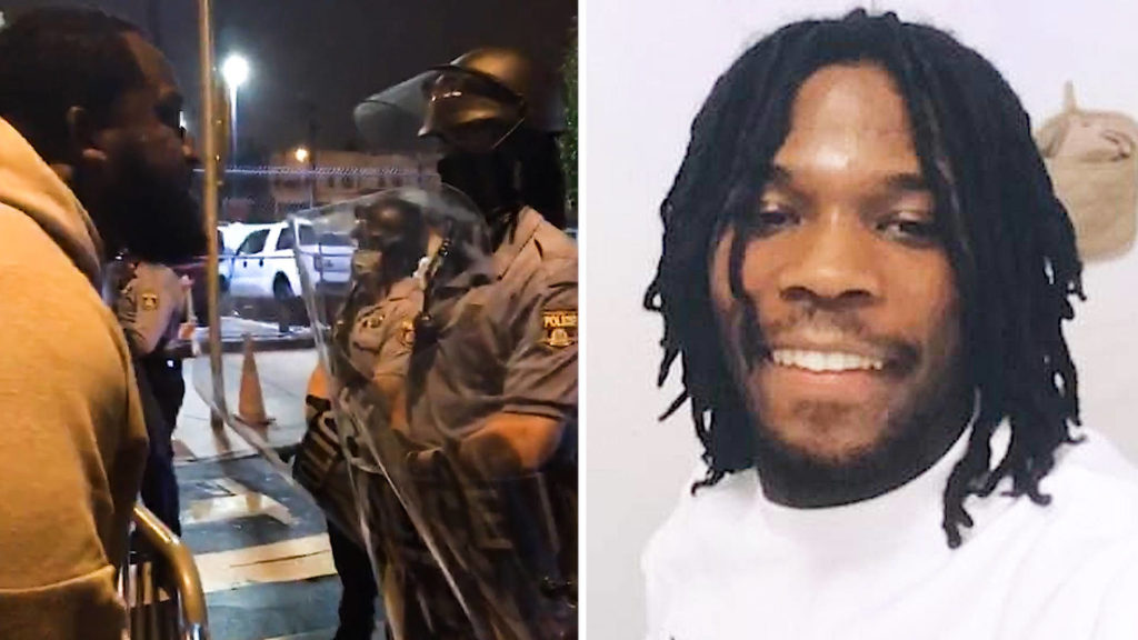 Man yells at police officers and picture of a man's face
