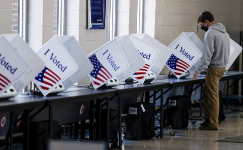 Man voting at a booth for the 2020 Elections