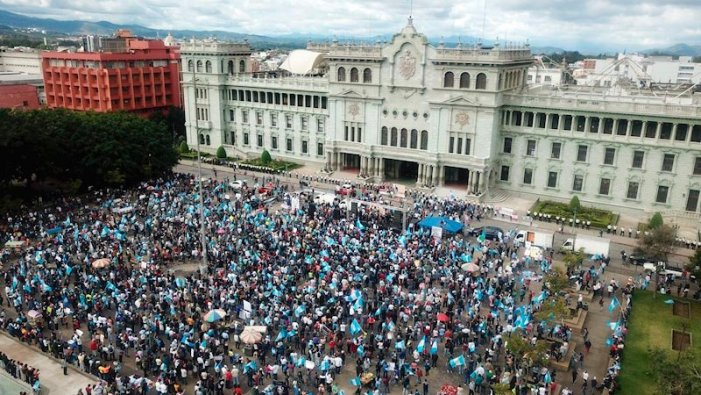 Crowds gather outside the Congress in Guatemala during a protest against President Giammattei