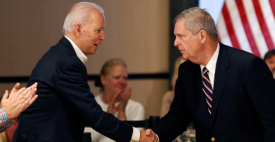 Joe Biden shakes the hand of Tom Vilsack, nominated as Agriculture Secretary