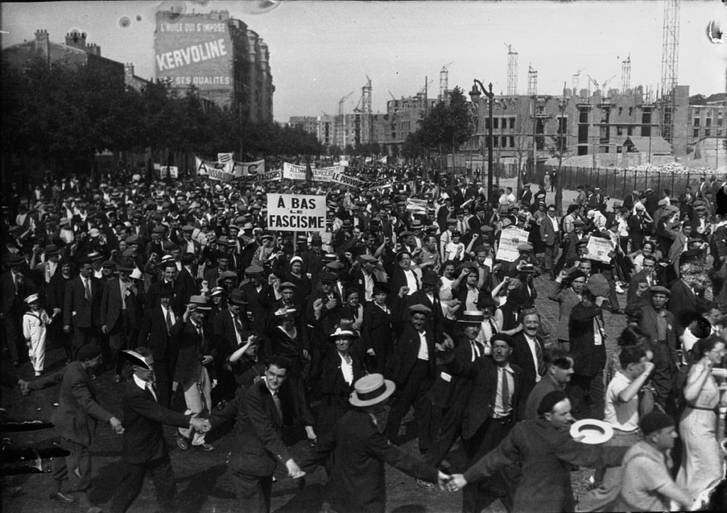 The photograph depicts a demonstration against fascism in one of the city's streets in 1934.