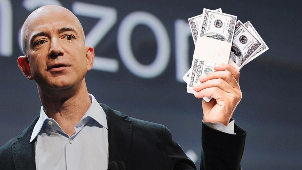 Amazon founder Jeff Bezos holds up a lot of cash.