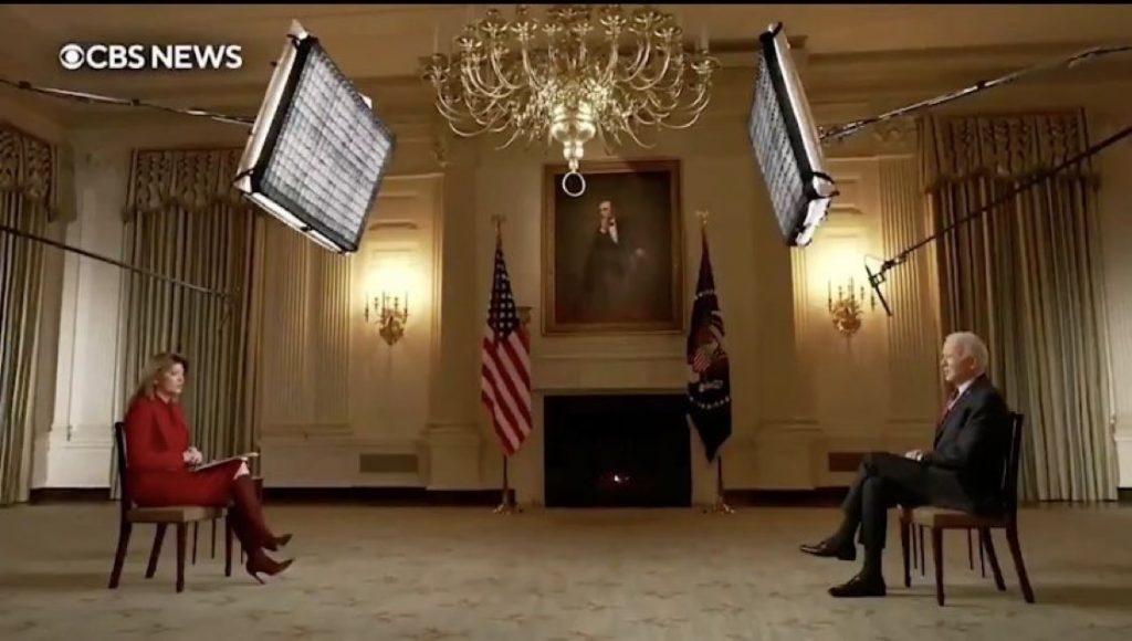 Biden sits far apart from a CBS interviewer.
