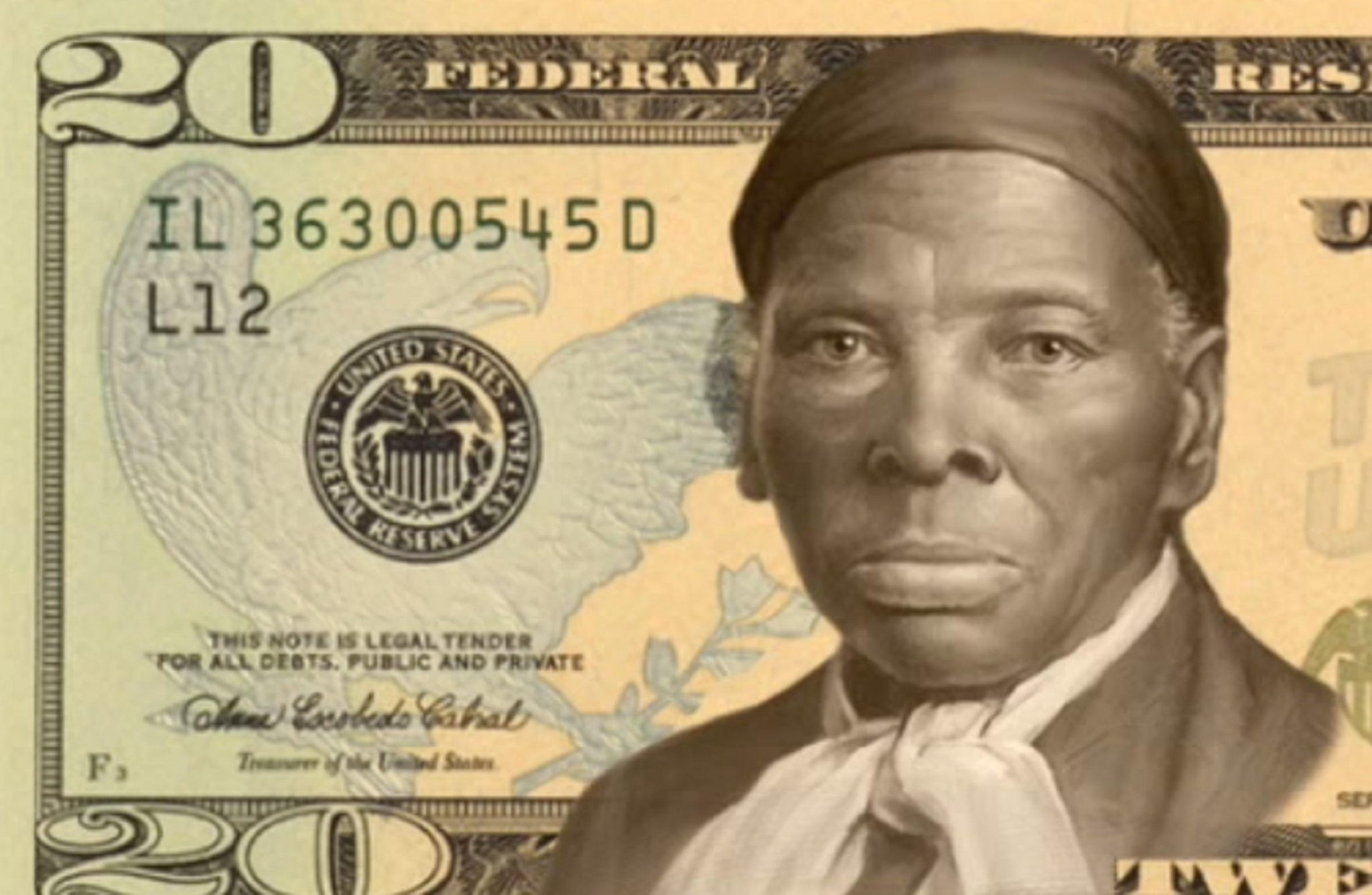 Harriet Tubman's face is superimposed on a 20-dollar bill.