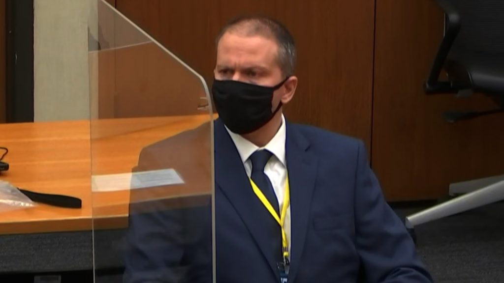 Derek Chauvin wears a suit and mask on the first day of his trial for killing George Floyd.