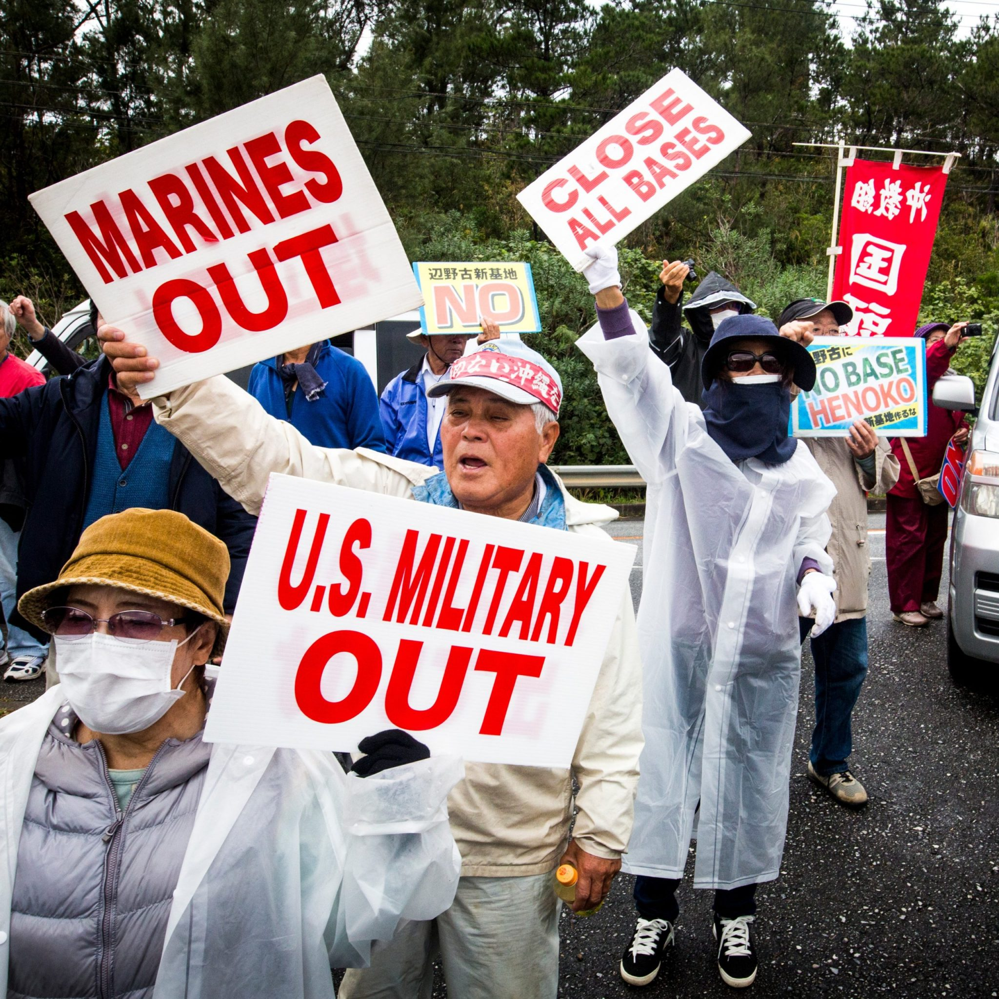The photo shows protesters in Okinawa at the site of construction of a new U.S. military base
