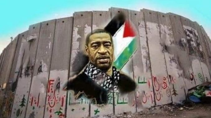 A wall mural of George Floyd wearing a kufiya. The Palestinian flag is painted behind him.