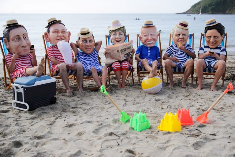 Paper mache heads of the G7 leaders.