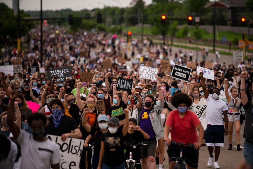 People marching in Minneapolis, Minnesota in response to George Floyd's murder.