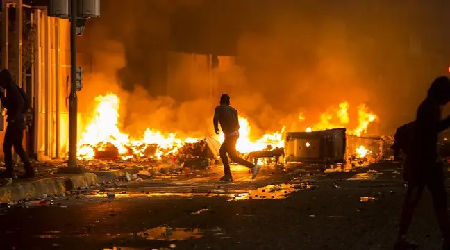 A silhouette of an adult running, against a background of fire and smoke. It is night time and the street is full of burning or burned debris