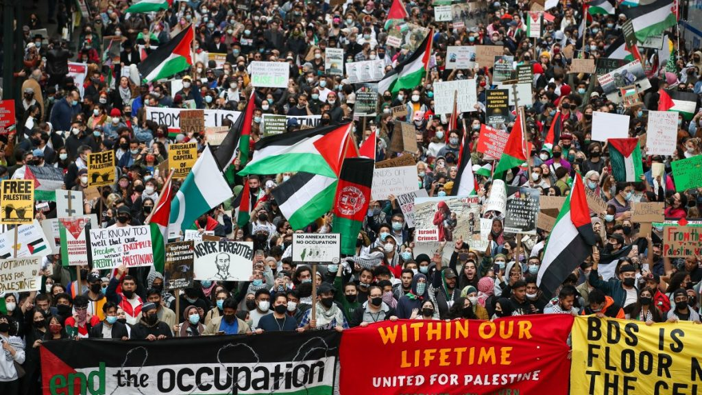 A large protest in New York for Palestinian liberation, many Palestinian flags in the crowd.