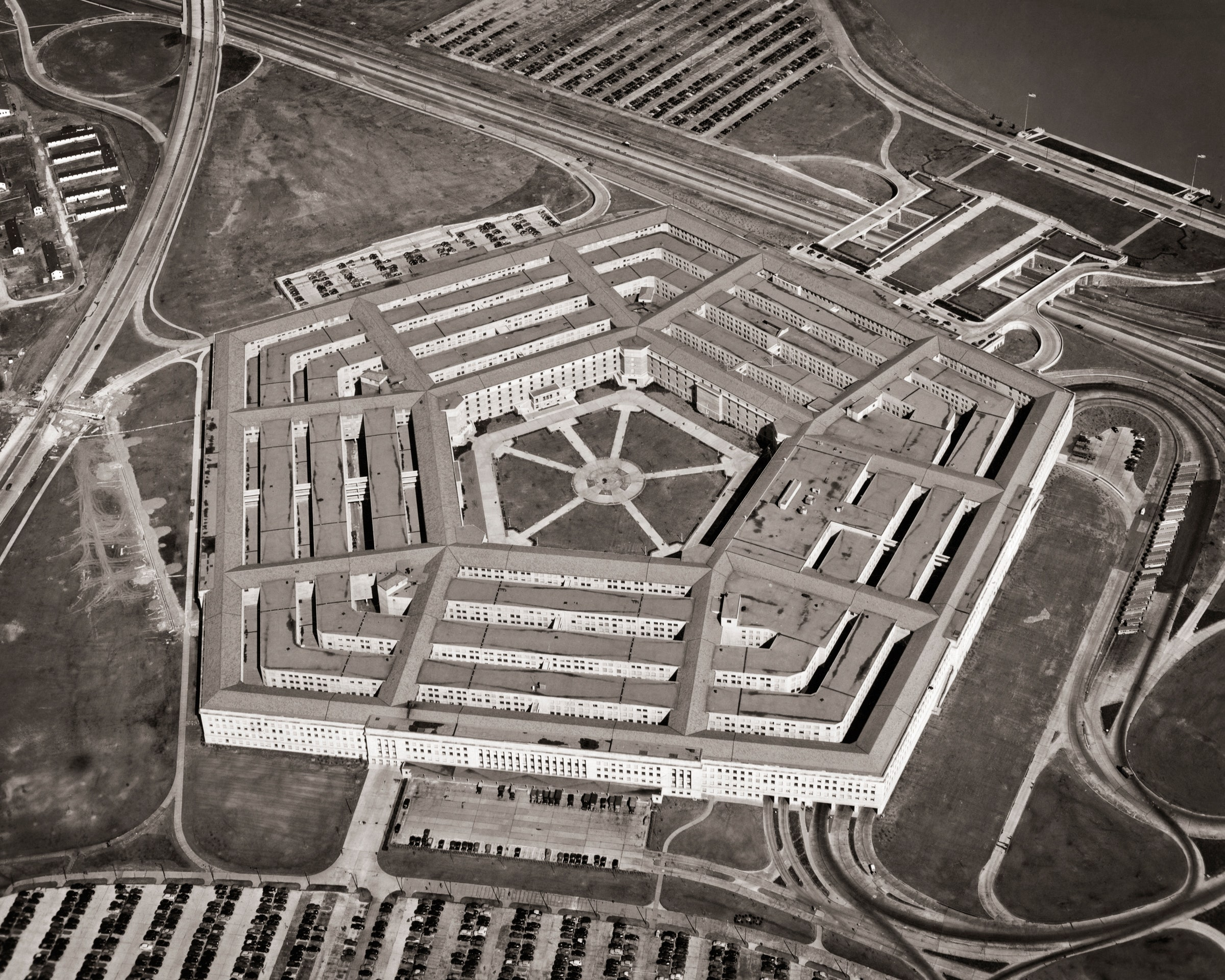 A black-and-white aerial view of the Pentagon in Washington, D.C.