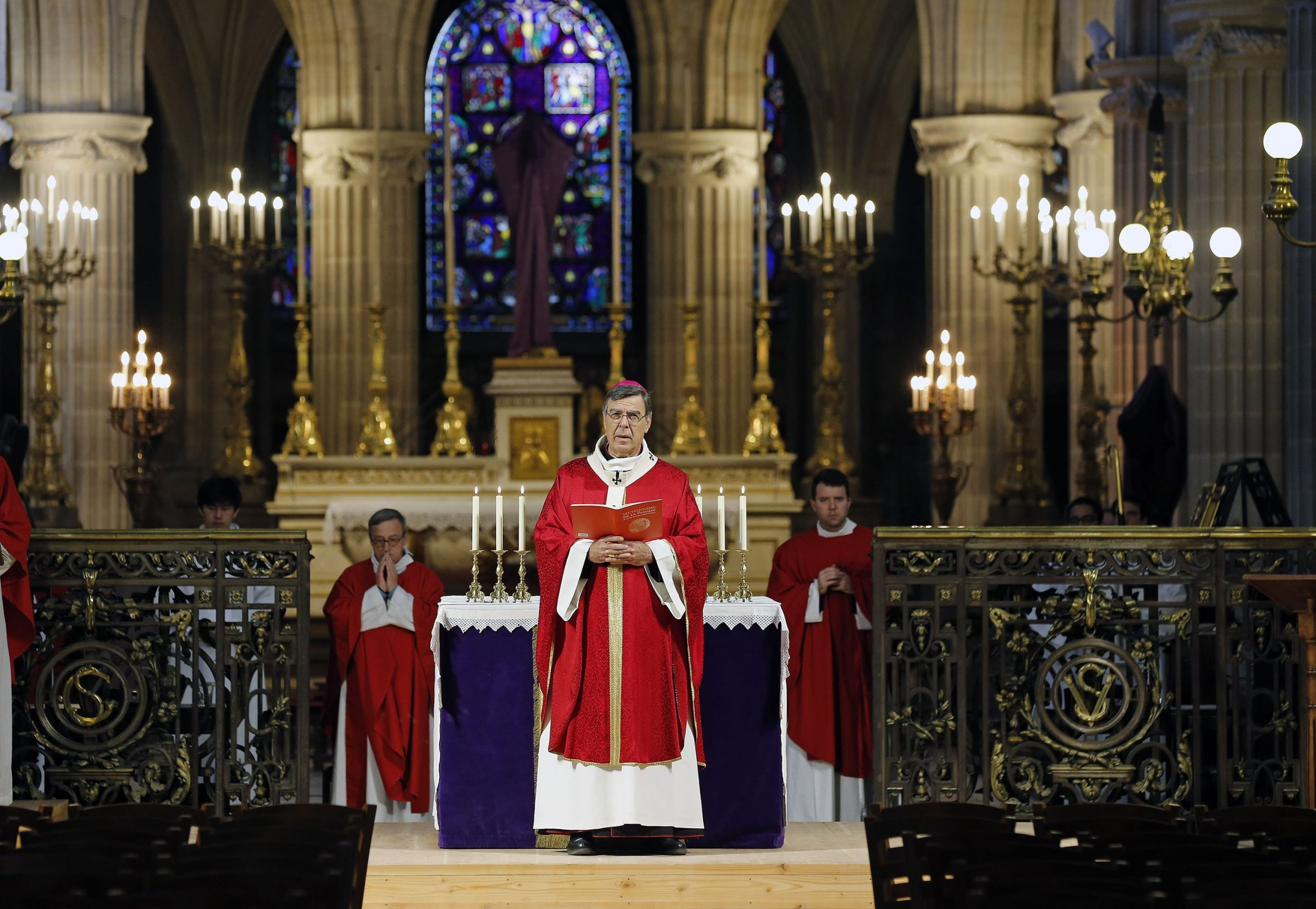 """Archbishop of Paris Michel Aupetit conducts Palm Sunday mass behind closed doors and inside an empty church at """"Saint-Germain-l'Auxerrois"""" during the early days of the COVID-19 pandemic, Paris, France, April 5, 2020."""