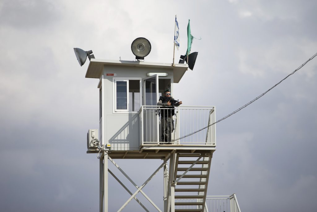 An Israeli border police officer watches from a tower at a checkpoint near the West Bank town of Nablus, Friday, Oct. 30, 2015. Israeli police said two Palestinians ran toward the West Bank checkpoint with knives in their hands, drawing Israeli fire that killed one and wounded the second.